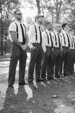 Groomsmen + Suspenders | AWB | via Groomsmen Swag.  If your wedding party has tattoos, heck...sport them!  Formal weddings and tattoos can work, just look at this groomsmen pic.