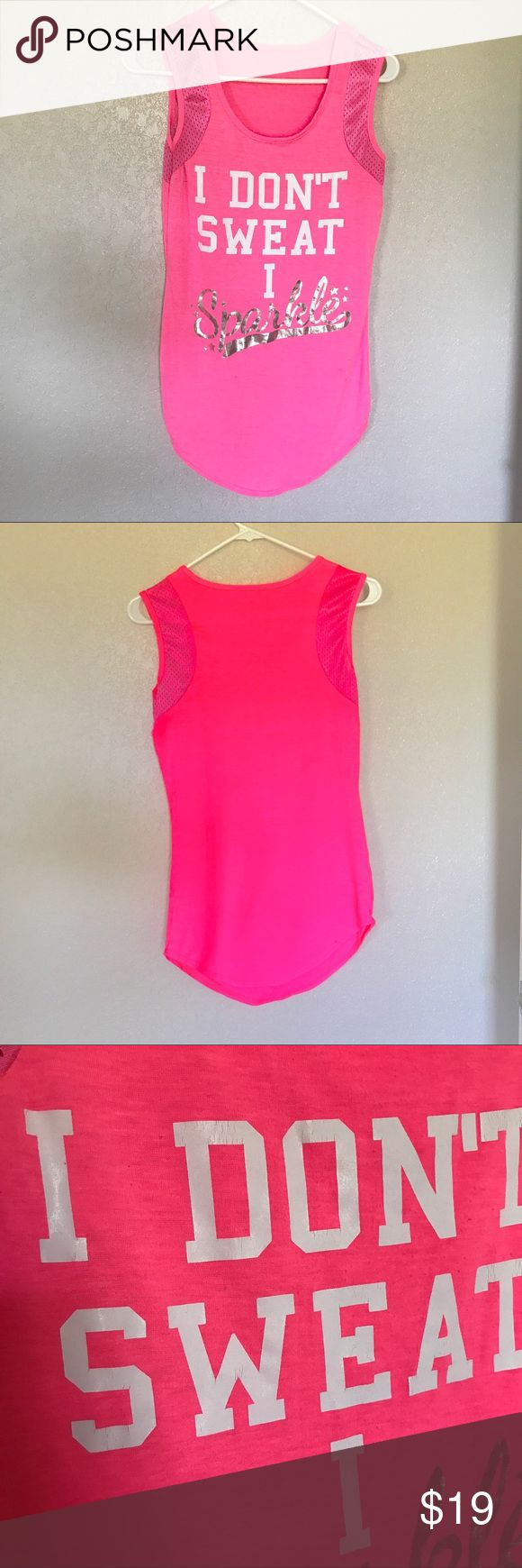 "Tank top. 💦💎""I don't sweat, I sparkle"" 💦💎 Super cute workout tank, or casual wear. Used but in good condition. No tag, tiny amount of peeling(pictured) not very noticeable! Hard to get a good pic of color. Color may vary by screen. Hot pink! Tops Tank Tops"