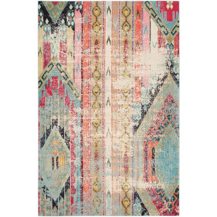 Set eye-catching style underfoot with this chic rug, showcasing a distressed geometric motif in vibrant hues.