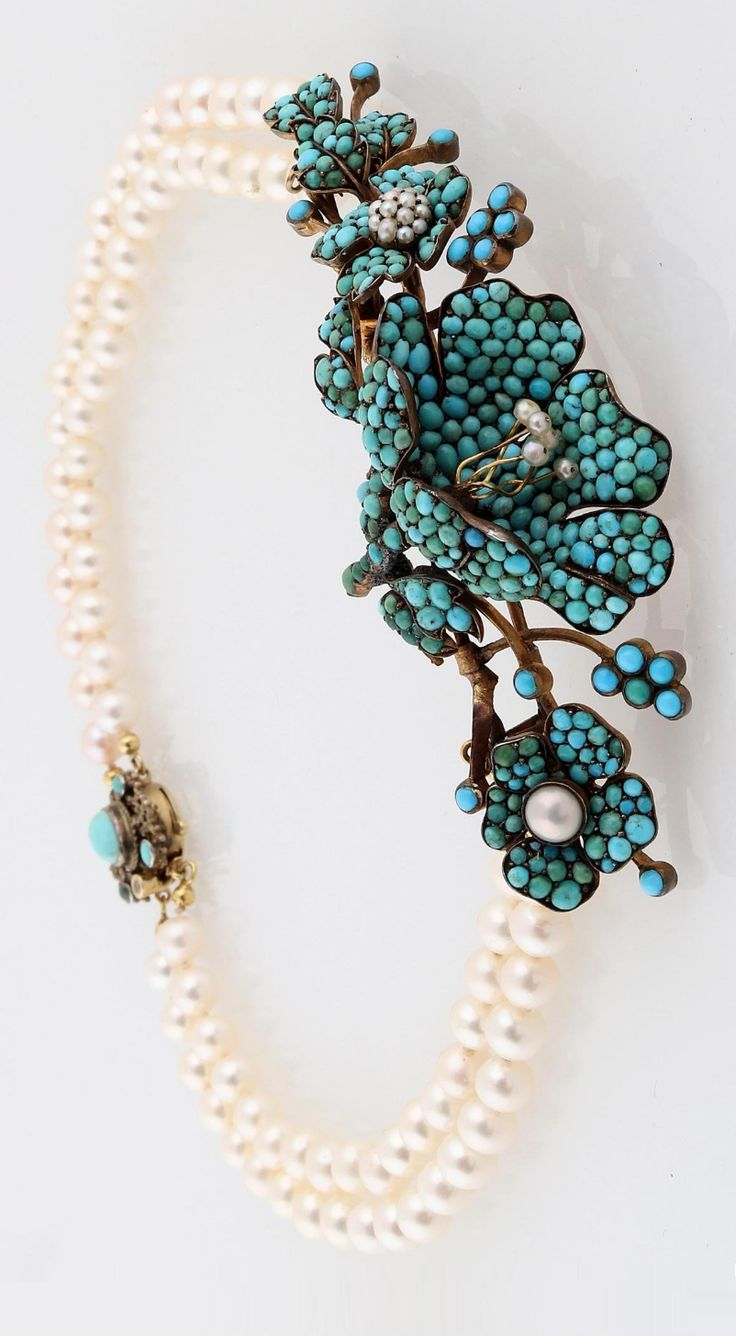 An antique freshwater cultured pearl and turquoise necklace, circa 1900. Mounted in gold and silver.