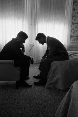 John F. Kennedy confers with his brother and campaign manager Bobby during the Democratic National Convention