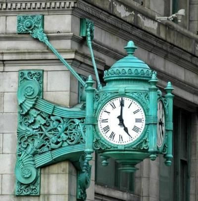 """Old world elegance - two famous Marshall Field's clocks are still with us. Both installed by 1907 and about 7 tons each, the iconic cast bronze design (Graham, Anderson, Probst & White) is familiar to most. The """"Great Clock"""" is at the corner of Washington and State. This is the corner that Chicagoans have long referred to when they say """"meet me under the clock."""" http://outofchicago.com/photographing-the-marshall-fields-building/"""