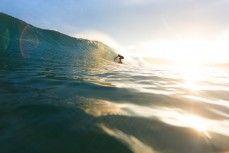 A surfer gets a cover-up at St Kilda Beach, Dunedin, New Zealand.