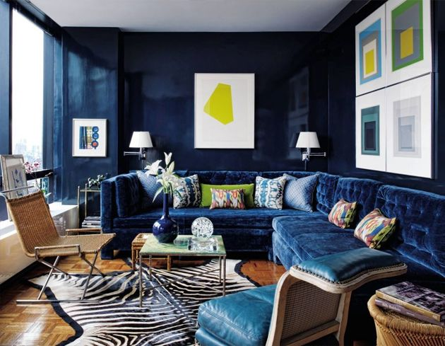 Bold and glamorous room by Todd Romano. Blue velvet sofas, bold blue walls, wood floor, animal print and tan. Love it. Moody and individual sophistication