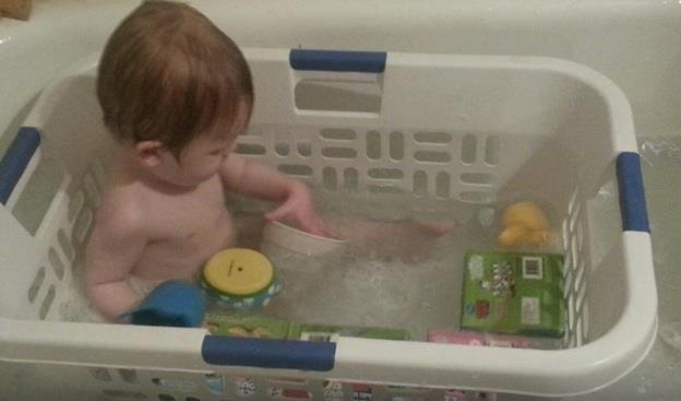 Sheer brilliance : his toys are all within reach, and he's safer in the tub.