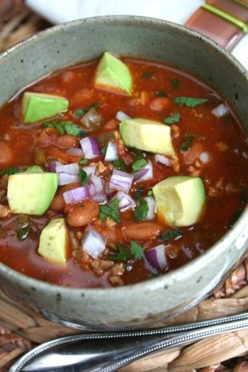 Healthy turkey chili recipe with loads of fresh vegetables, lean meat and by all means beans!