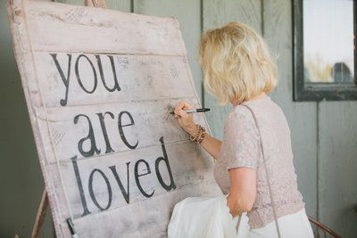 """You are loved"" wooden sign people sign as guest book at rustic barn wedding.  Can hang on the wall in your new home!"