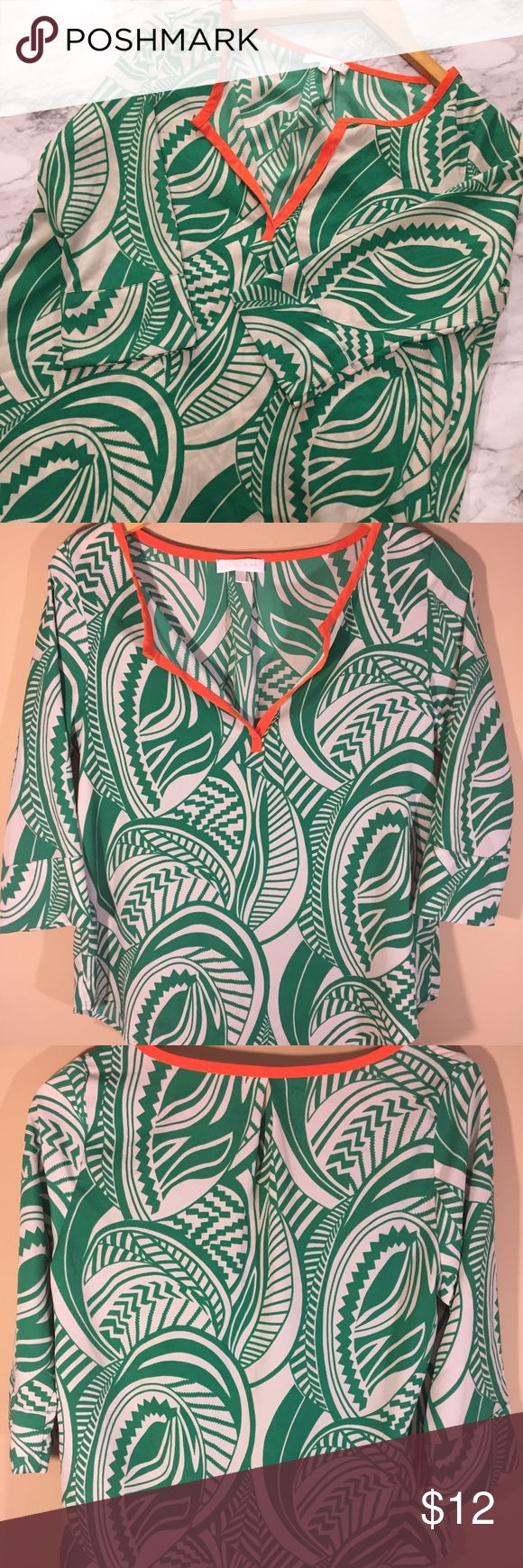 "GLAM Tropical Print Top Green Orange Semi-Sheer Lightweight, bold print GLAM top. Bright green tropical feel print on a grey-ash taupe background with bright orange neckline. 3/4 sleeves with slight flare at the cuff.  In great pre-owned condition, minimal signs of wear.  Measurements (taken laying flat) Underarm to underarm: 18"" Length: 24"" GLAM Tops Blouses"