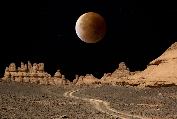 Composite image of the blood moon created by the lunar eclipse and the Acacus mountains in Libya.
