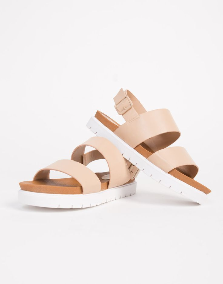 These Banded Leather Flatfrom Sandals are all about comfort. Pair these sandals with a casual sporty one-piece outfit for a comfy day out.