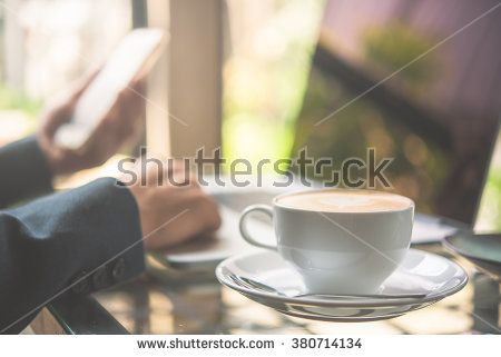 cappuccino cup with business man and laptop background  - stock photo