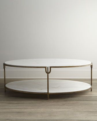 "$1999 The timeless design of this incredibly sophisticated oval coffee table adds soft balance to the angular lines of living areas. Two tiers of honed white marble provide ample display space.  Made of hammered iron.  Hand-painted golden finish.  52""W x 30""D x 18""T.  Imported.  Boxed weight, approximately 364 lbs."