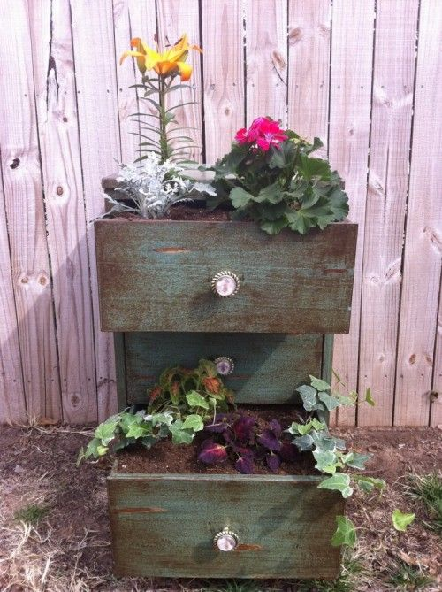 """Old Dresser Planter...or just the drawers.  You could also """"make"""" the drawers out of pallet wood for some inexpensive plant containers."""