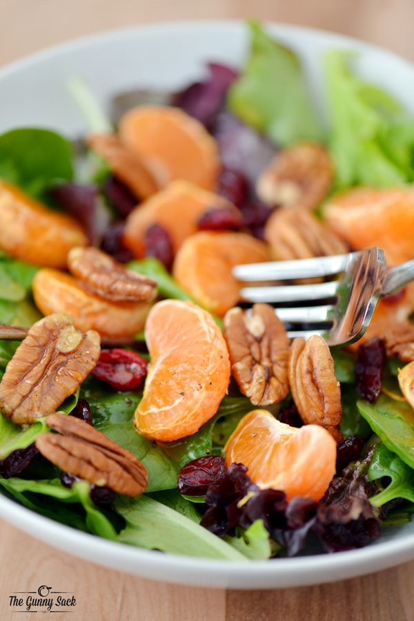 This Citrus Salad recipe with Honey Citrus Salad Dressing is perfect for lunch! The salad is topped with clementines, walnuts and dried cranberries. | thegunnysack.com