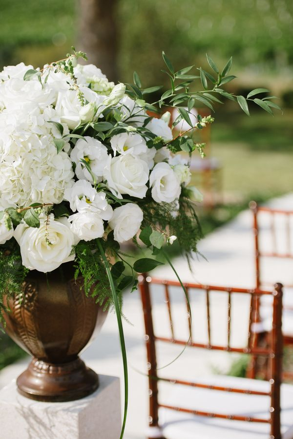 Edgy Petals - Elegant White Altar Arrangement | photography by http://melissagidneyphoto.com