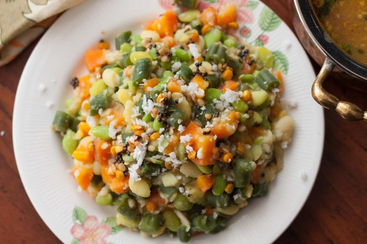 Vegetable & Avarekalu Kootu Recipe is a healthy side dish that has steamed carrot, green beans and avarekalu mixed along with moong dal and tempered with mustard seeds, curry leaves and hing. It will make a delicious side dish along with steamed rice and rasam. The Poricha Kootu is a traditional south Indian recipe that is great comfort food. Serve the Vegetable & Avarekalu Kootu Recipe along with steamed rice, Thakkali Rasam Recipe and end it with a curd rice. If you...