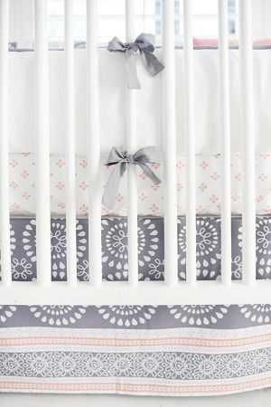 Unique, beautiful and girlie! The perfect crib bedding for a a sweet girls nursery! Love the updated look of grey and pink!