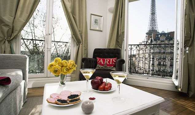 Champagne Romantic Paris Apartment Rental Eiffel Tower View wrap around balcony