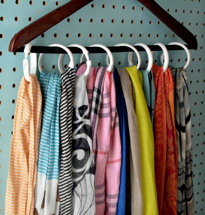 Instead of draping them across whatever's in your path (the back of a chair, a door knob, your bed post), corral scarves neatly together on just a single hanger. This also works perfectly for other accessories, like belts and handbags.  See more at Hip 2 Save »  - WomansDay.com