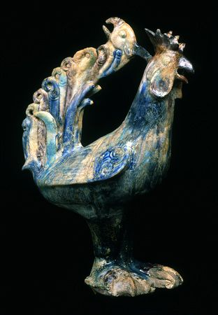 Cock, cast, modeled and carved fritware, painted in blue, turquoise, and manganese under a transparent glaze  Syria, Raqqa; 2nd half of 12th century  H: 38.5 cm