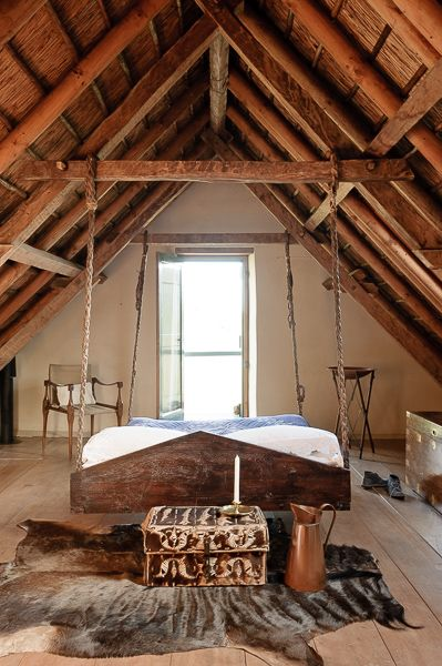 Floating in the middle of the room AND hanging from the ceiling And beams arrowing (cutting) through the bed And the head is facing out the door. ~smh