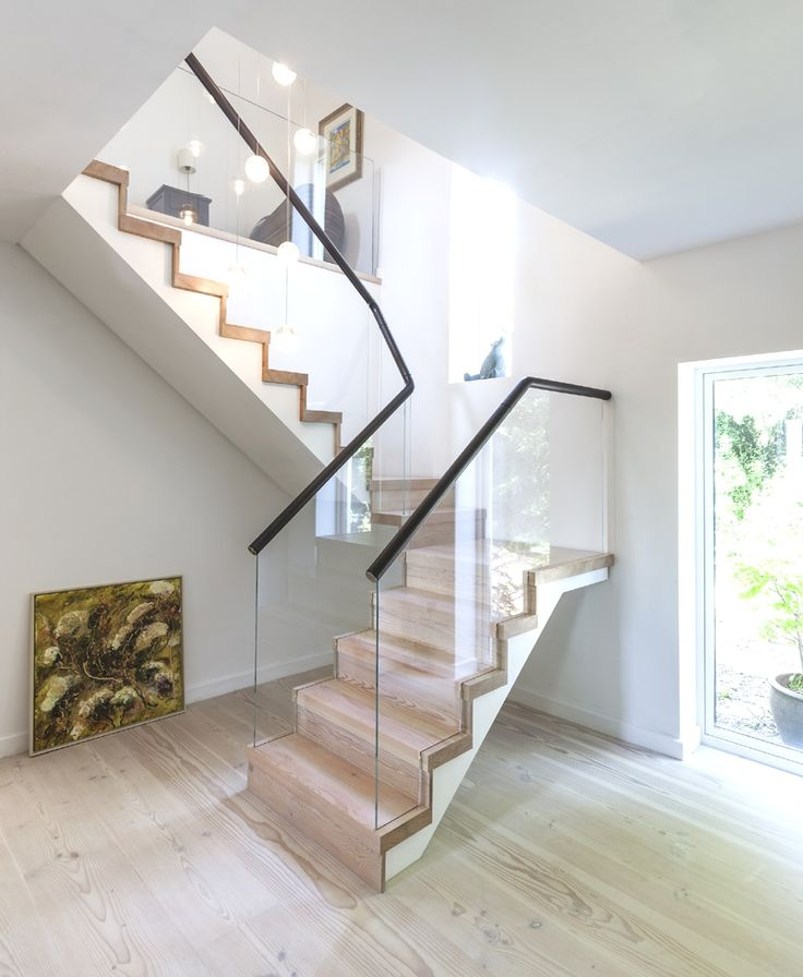 A contemporary staircase with timber treads, glass balustrades and leather handrail    #KBHome