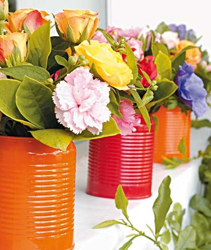 Spray acrylic pain on tin cans & insert flowers. Would be good as table pieces, window decor, shelf focus, etc.