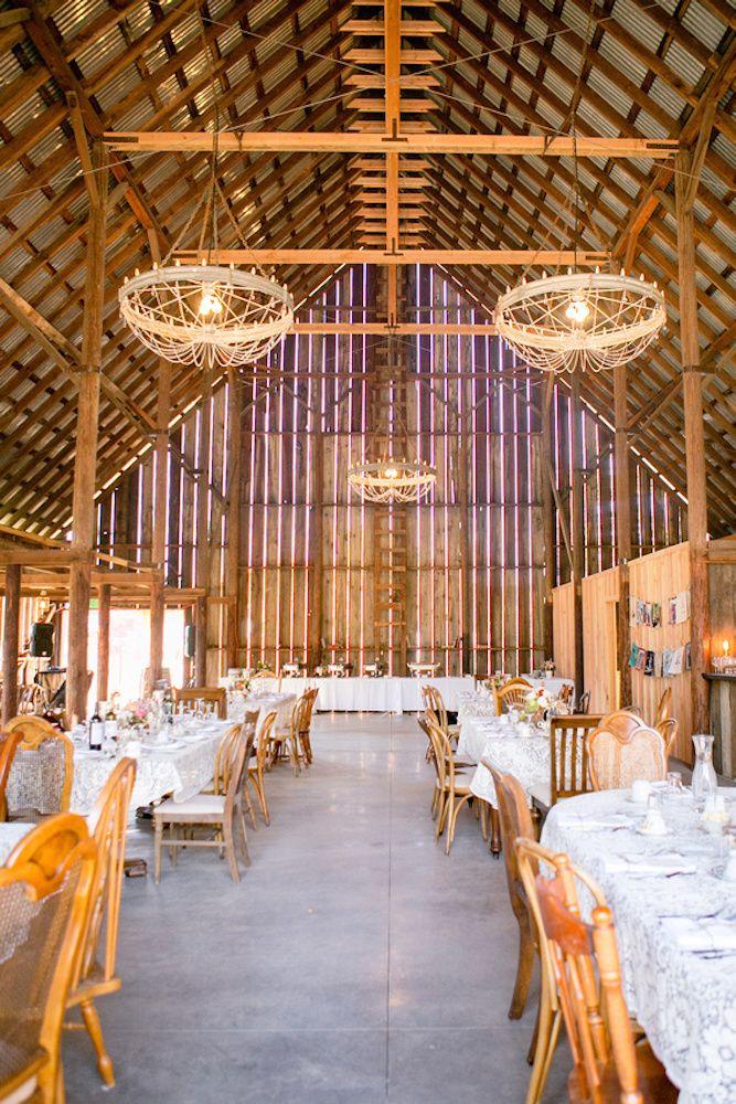 Barn Wedding Reception With Huge Chandeliers
