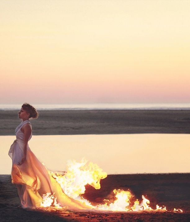 The fire licks my dress, stealing the fabric, bringing it home. The flames paint my legs, and I feel myself returning to bird form.