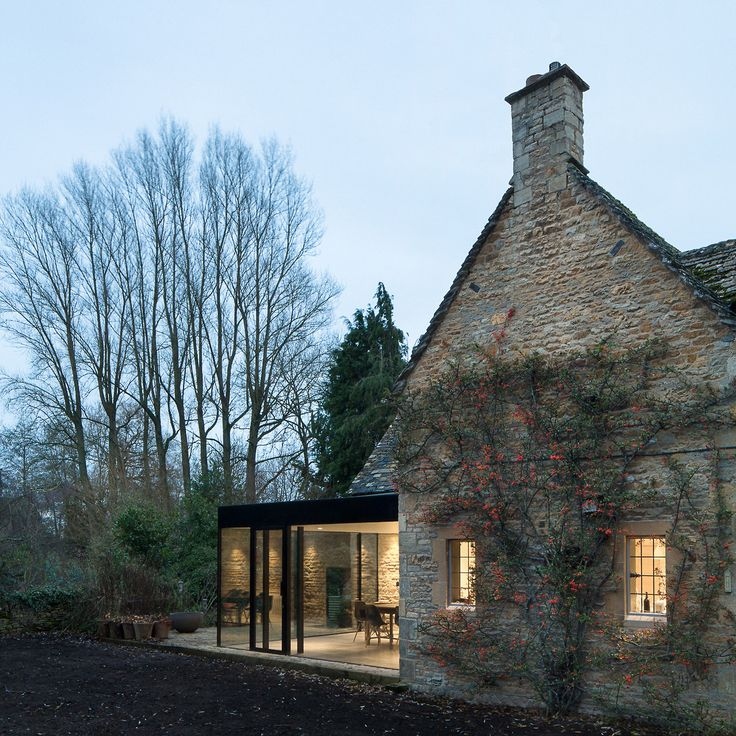old stone English cottage and modern glass extension.