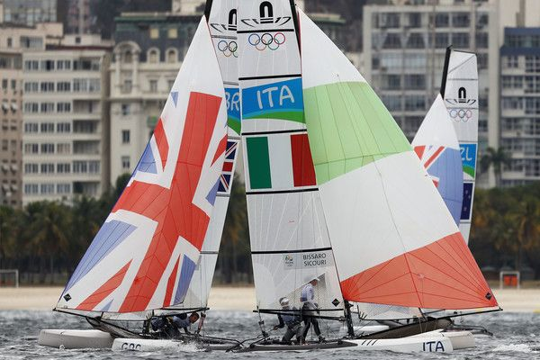 Ben Saxton of Great Britain and Nicola Groves of Great Britain and Vittorio Bissaro of Italy and Silvia Sicouri of Italy compete in the Nacra 17 Mixed class on Day 5 of the Rio 2016 Olympic Games at the Marina da Gloria on August 10, 2016 in Rio de Janeiro, Brazil.