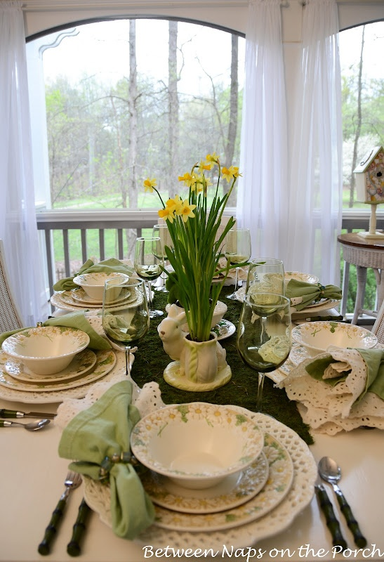 Spring Easter Table Setting With Daffodil And Moss Centerpiece