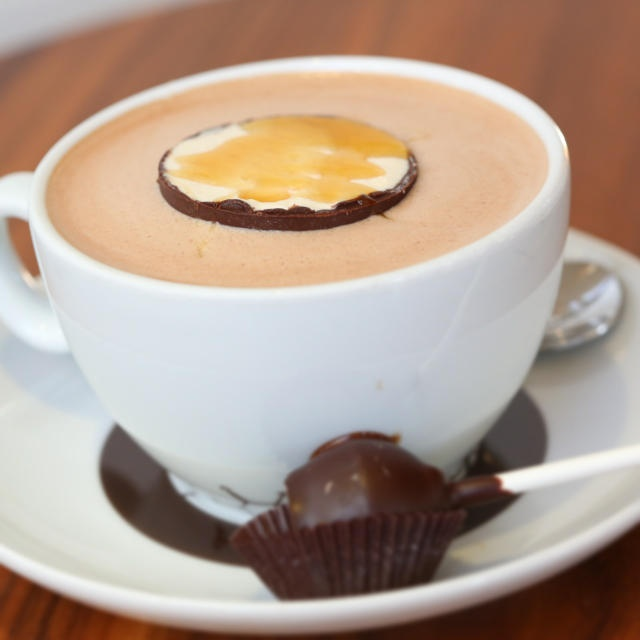 "From Thomas Haas Chocolates ...   #60 - ""MALTEASER""  Barley malt-infused hot chocolate,  served with salt caramel malt truffle and malteaser lollipop. Photo by @mightyvanilla"