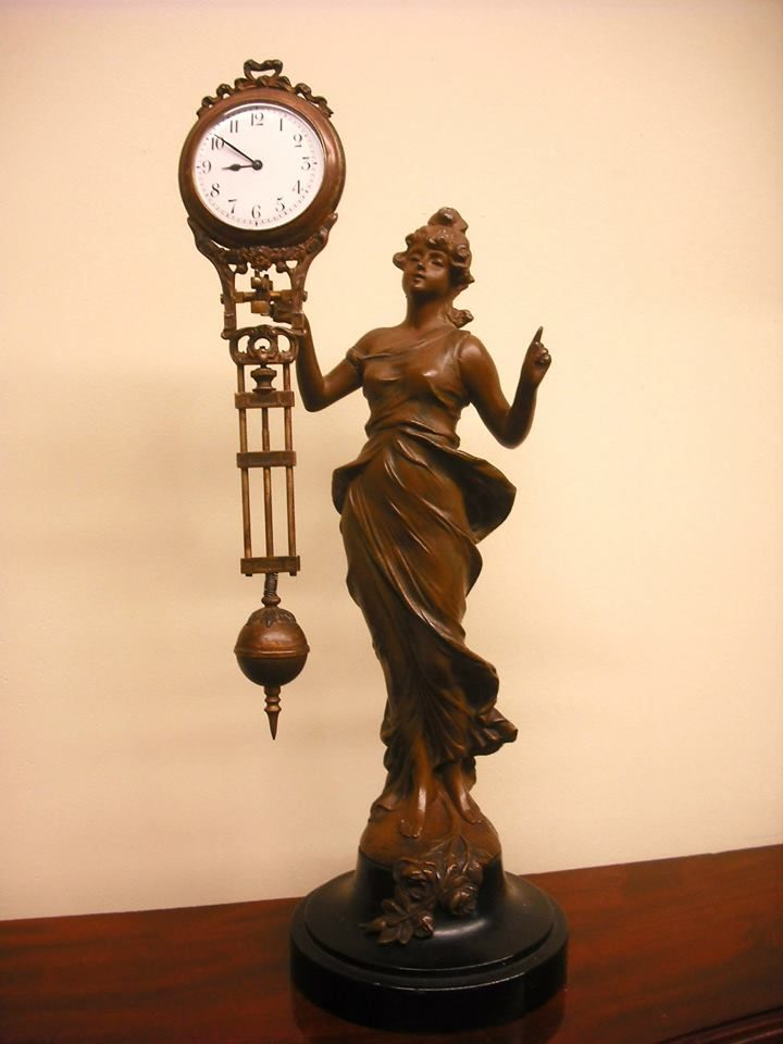 Antique clock swinger
