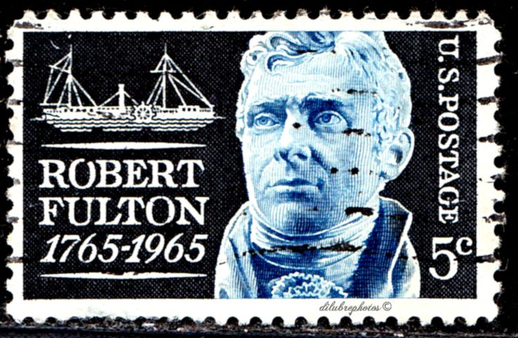 USA.  Robert Fulton Issue.   Robert Fulton & Clermont.   Fulton (1765-1815), inventor of the 1st com- mercial steamship.  Scott  1270 A702, Issued 1965 Aug. 19,  Perf. 11,  Giori Press Printing , 5c. /ldb.