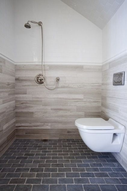 Pay attention to proportion and break up the tile accordingly. While using the same tile all over a bathroom can work, other spaces may need breaking up. In this case, the ceiling height is much greater than the width, so using a white tile overhead gave this room pleasing proportions. Bonus: Using a less expensive tile up high can keep the tile from breaking your budget.