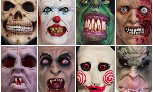 Halloween masks for sale at a shop in Berlin. Photograph: Thomas Peter/Reuters  ~1eyeJACK~