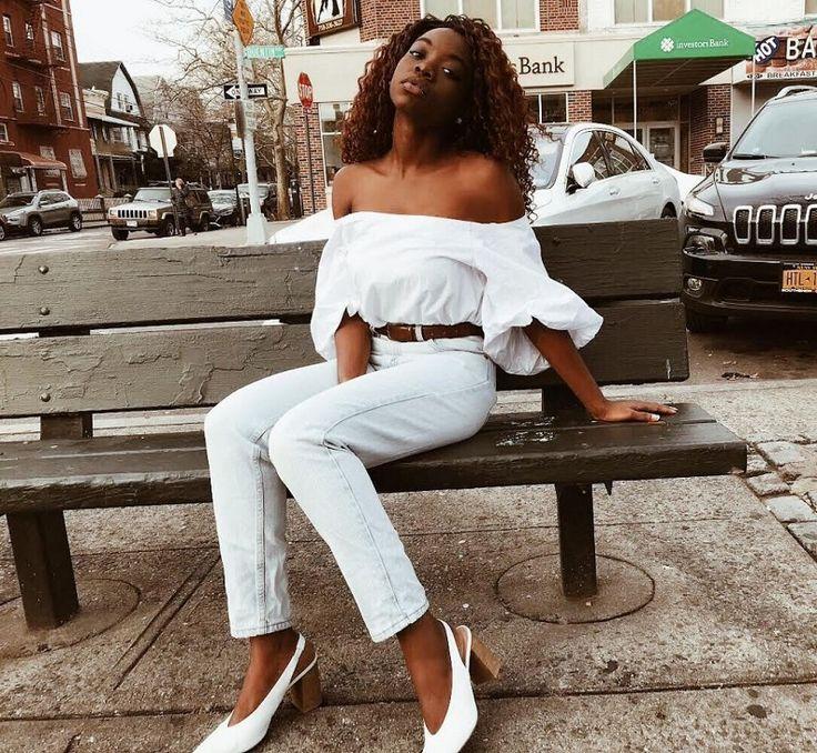 White of shoulder top on denim jeans