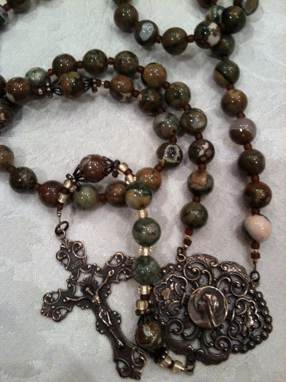 10mm Rhyolite round bead rosary with large bronze Mary center and crucifix. $90