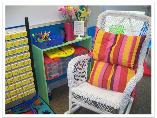 Check out this beautiful classroom that simply immerses students in reading! Comfy chairs, pillows and bright colors all add to the welcoming environment.