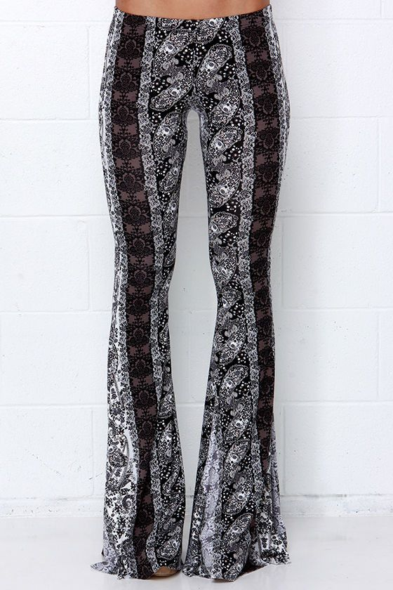 Black and Ivory Print Flare Pants are on par with our favorite bell flowers! Lightweight jersey knit rayon with a Boho floral striped print begins at an elastic waist and travels effortlessly into wide-flaring pant legs. Seaside Boutique