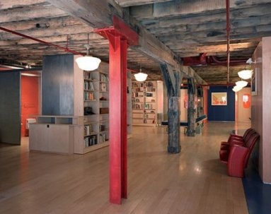 I love the gray ceiling and light floors with a pop of red.  Some industrial lighting...perfecto!