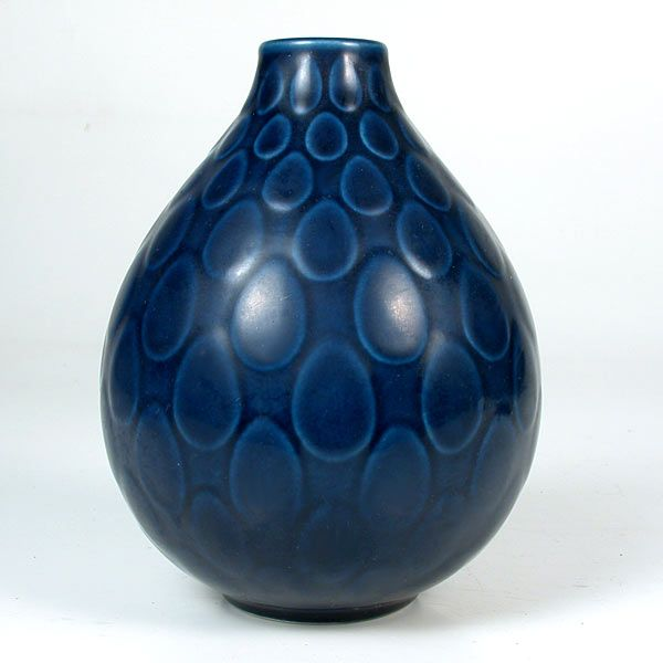 A Royal Copenhagen Aluminia Marselis vase designed by Nils Thorsson in the 1950's. The vase has a cobalt matte glaze with a raised tear drop design.