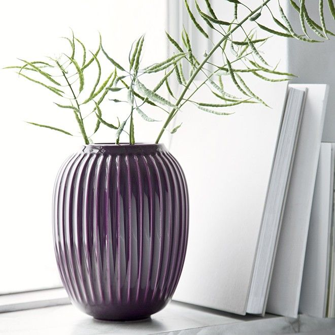 Use the medium-sized Hammershøi vase in the loveliest violet plum colour to decorate your dining table with pretty, fresh flowers - or enhance its deep, warm violet glaze by letting it stand alone or together with Hammershøi vases in other sizes and colours. The fascinating glaze flows lightly over the surface of the ceramic to create a lively, nuanced look.