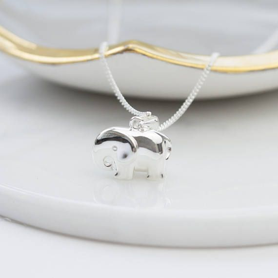 An enchanting solid silver elephant charm on a silver chain.  Elephants symbolise strength and power, longevity and success, wisdom and loyalty - and of course they are completely loveable.  Whatever an elephant means to you, you cannot fail to be captivated by our gorgeous charm.  Crafted in solid silver it manages to be both stylish and cute and the kind gift you buy for a friend but just want to keep for yourself!  Hangs on a curb chain and comes gift boxed.  Materials: Sterling silver…