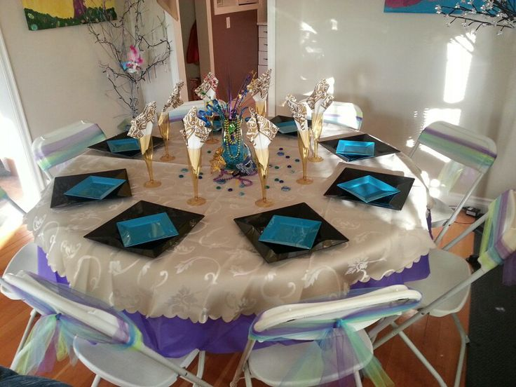 Table setting for masquerade birthday party