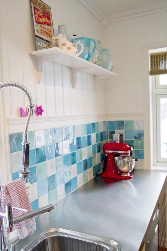 Love the bright aqua, red, yellow scheme for the kitchen.