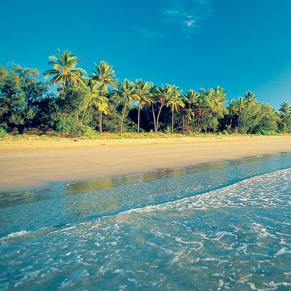 Soak up the sun on Port Douglas Beach, Australia.
