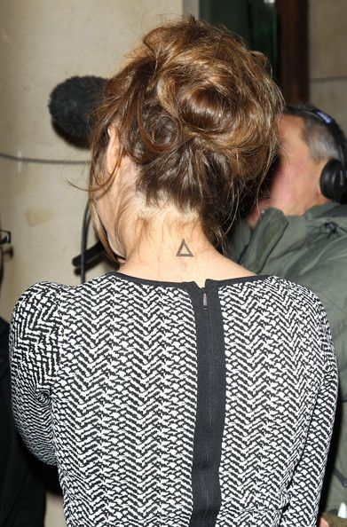 neck triangle tattoo...not usually a tat person but i like this
