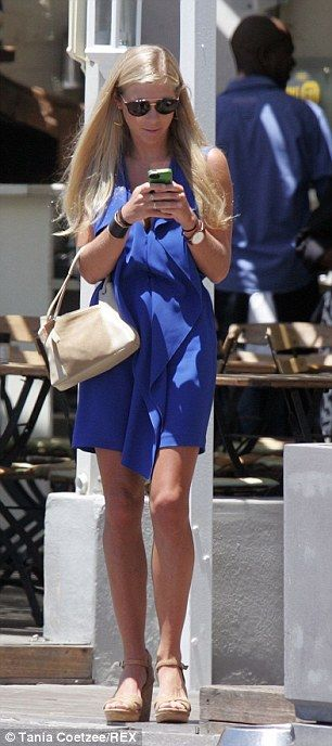 Chelsy Davy texted on her phone after wearing her hair long and loose